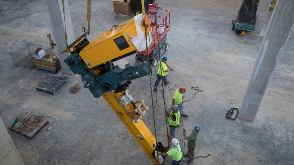 The robotic book retrieval and delivery system is lowered into the new library.