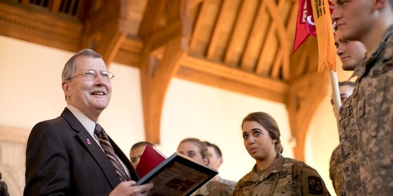 ROTC students present their Ranger Challenge Award to President Richard M. Englert