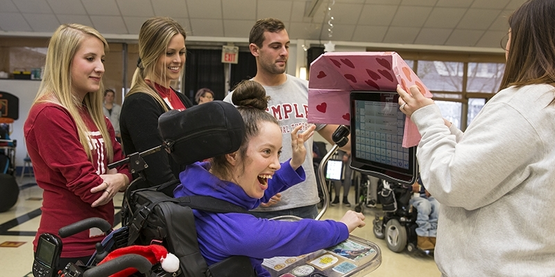 """Diana """"D"""" Rich, a student, receiving a customized visor for her communication device."""