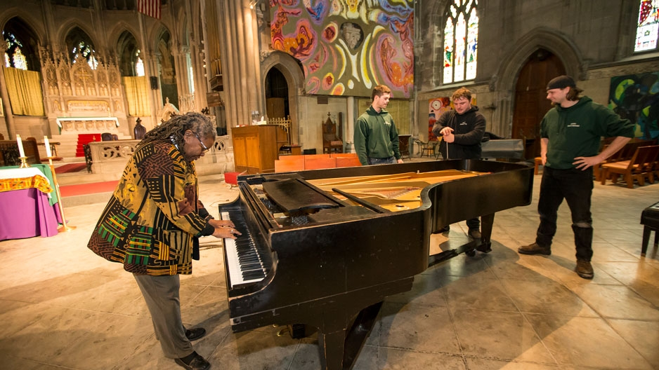 The Rev. Renee McKenzie plays a piano donated by Temple