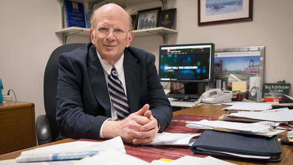 Assistant Vice President and Bursar David Glezerman sitting at his desk