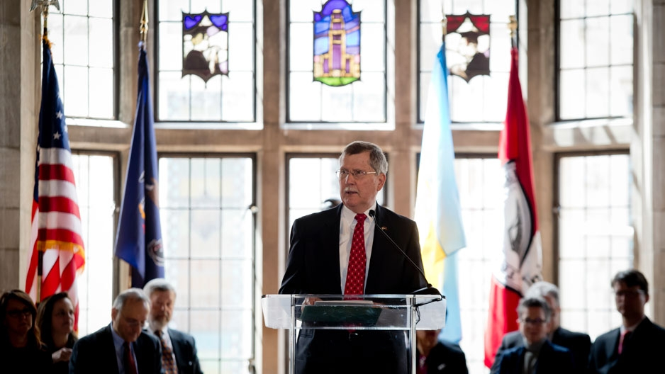 President Richard M. Englert speaking at a podium
