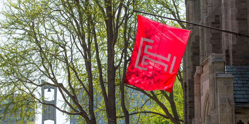 The Temple flag flies outside Sullivan Hall.