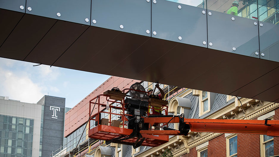 Man working on construction at Fox skywalk
