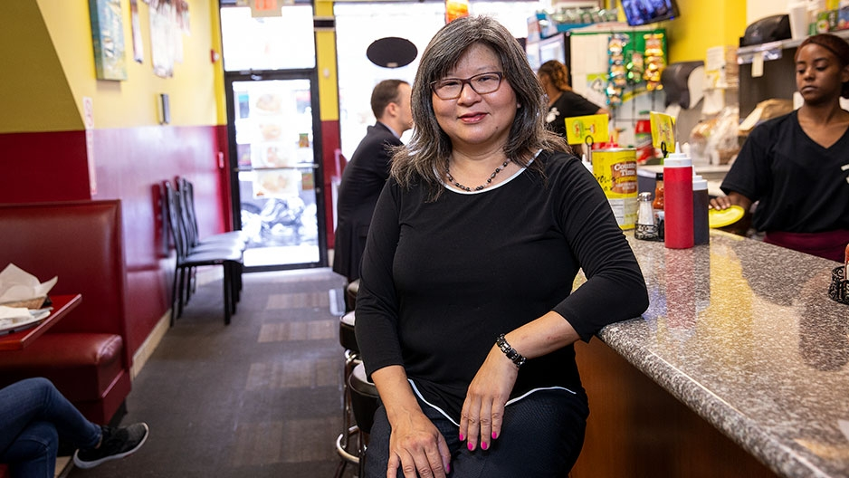 Shirley Moy sitting at a diner counter
