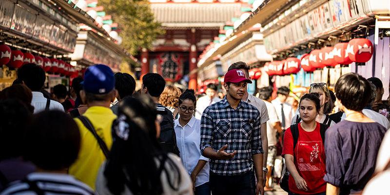 People walking down a street in Tokyo