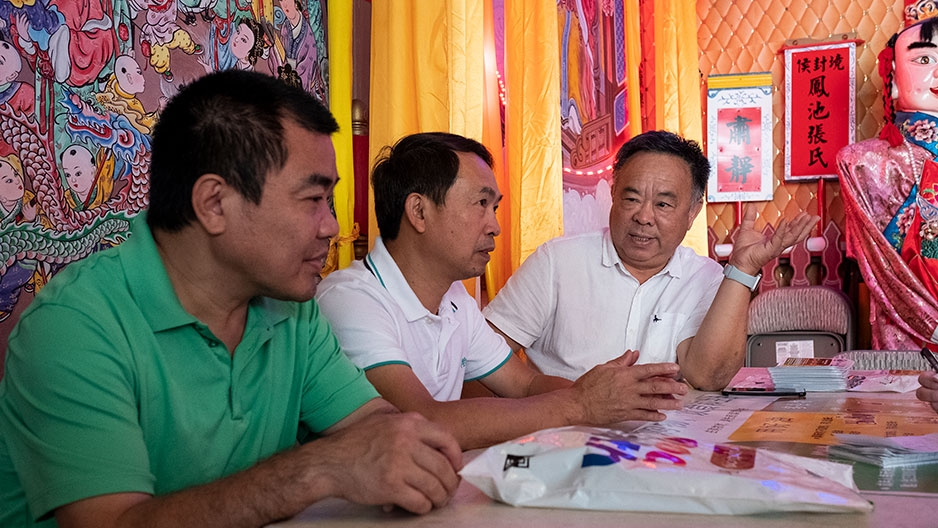 Steven Zhu and two restaurant owners