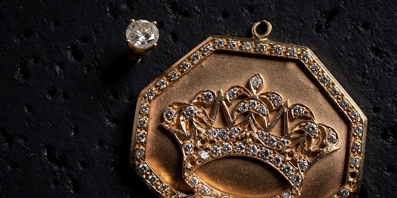 Tupac diamond earring and gold crown medallion