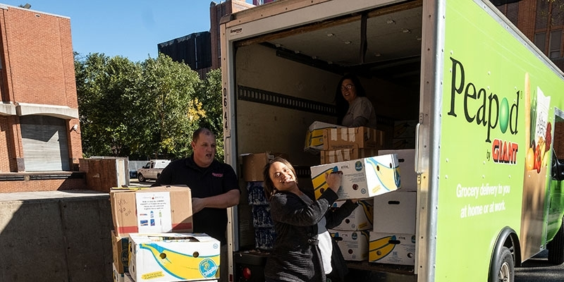people unloading a Giant truck packed with donations