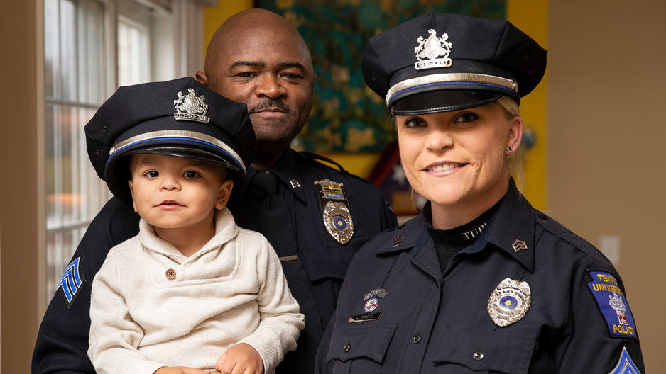Sergeants Kamari and Lauren Boone with their toddler son