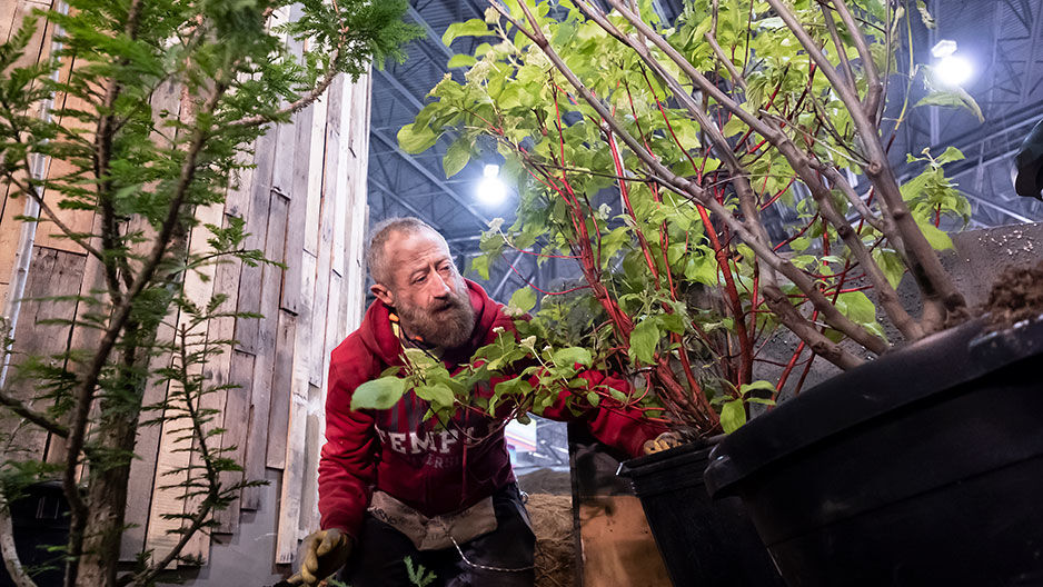 Michael LoFurno working on Flower Show exhibit