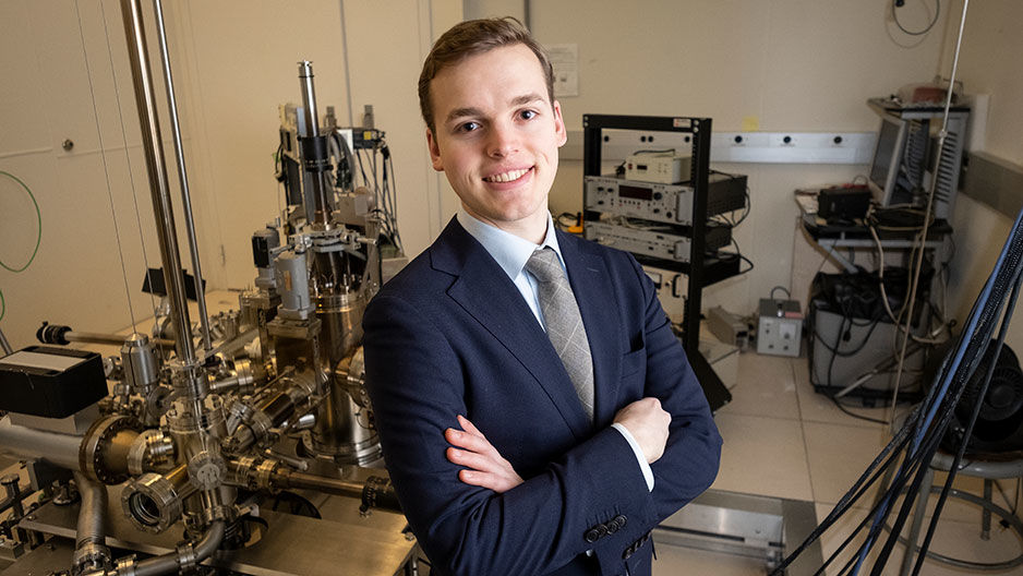 Marcus Forst, a senior physics major, stands in an applied physics lab