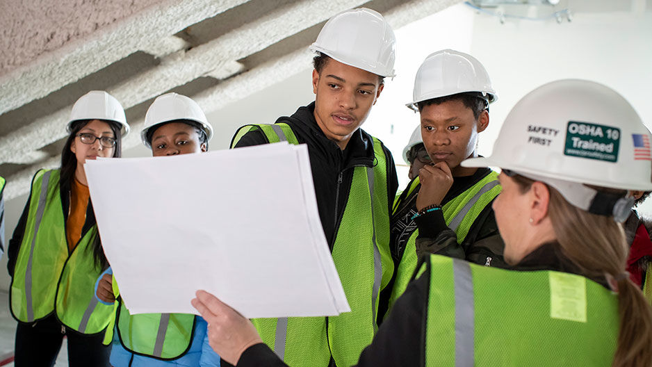 Students tour the Charles Library construction site