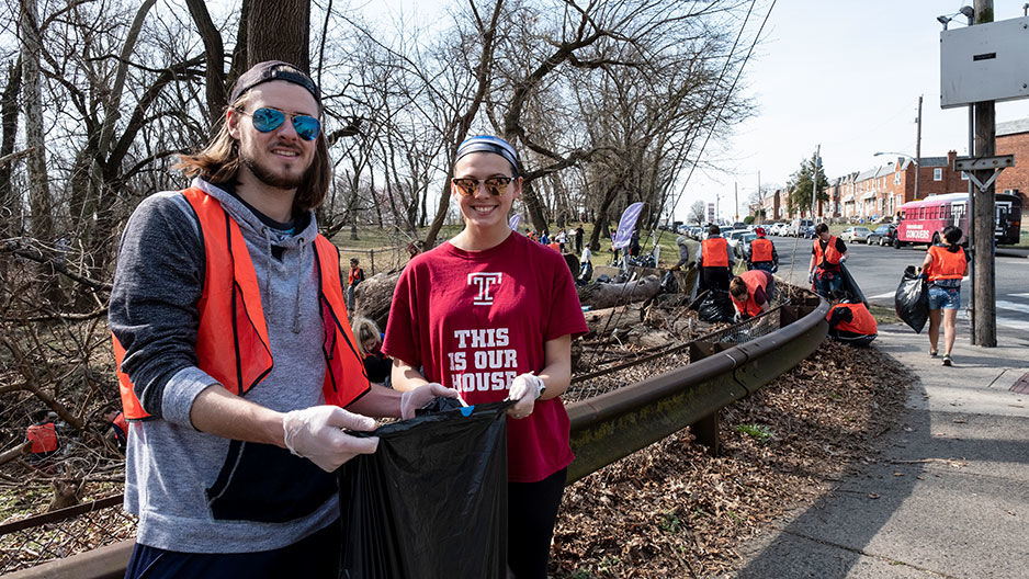 James Maguire and Meara Kuhfahl at a park cleanup