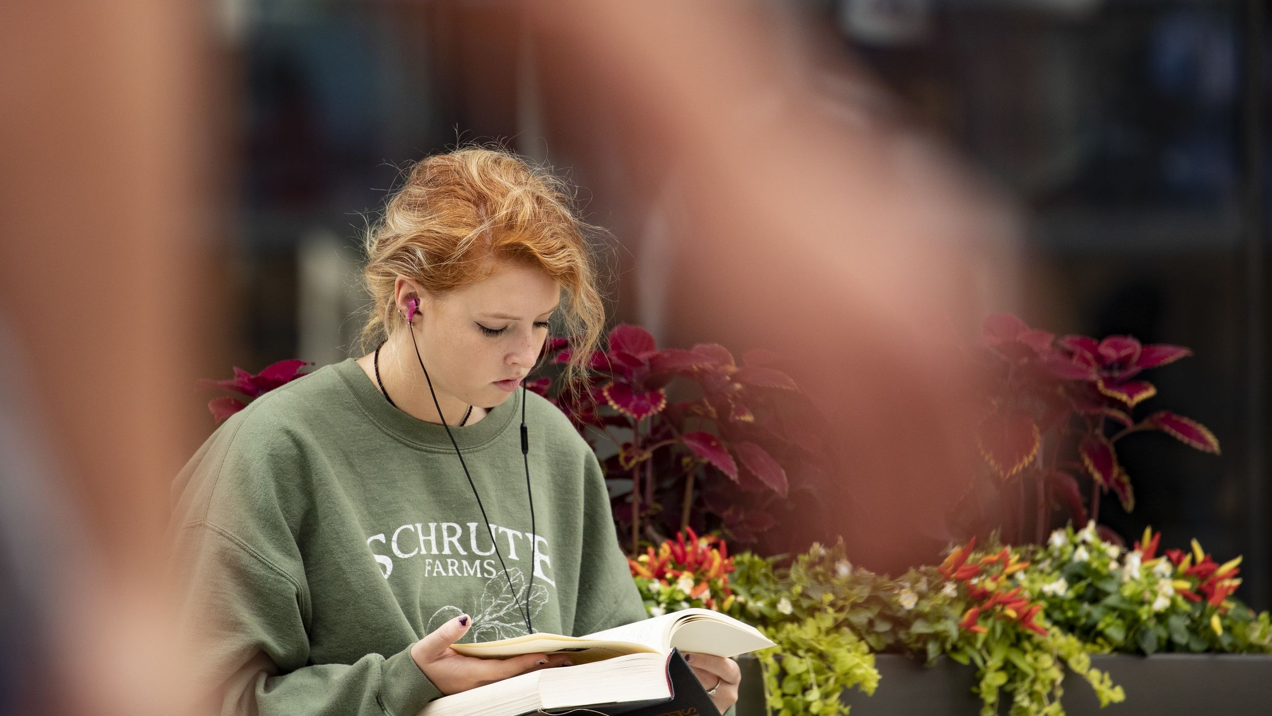 A student reading outside Charles Library