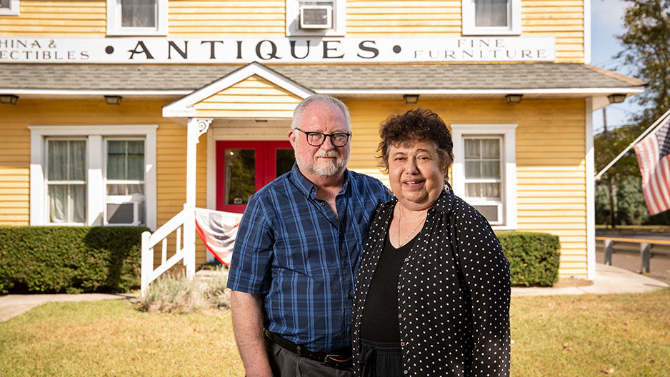 Mary DeMaio and Wayne Stewart outside their antique shop in Cape May