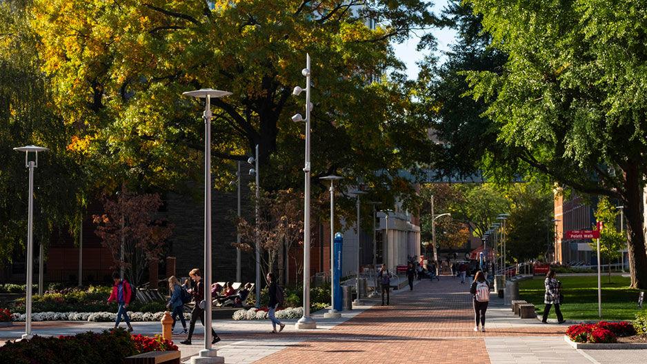 students walking Temple Universitys Main Campus in autumn