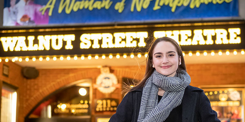 Audrey Ward standing in front of the Walnut Street Theatre in Philadelphia