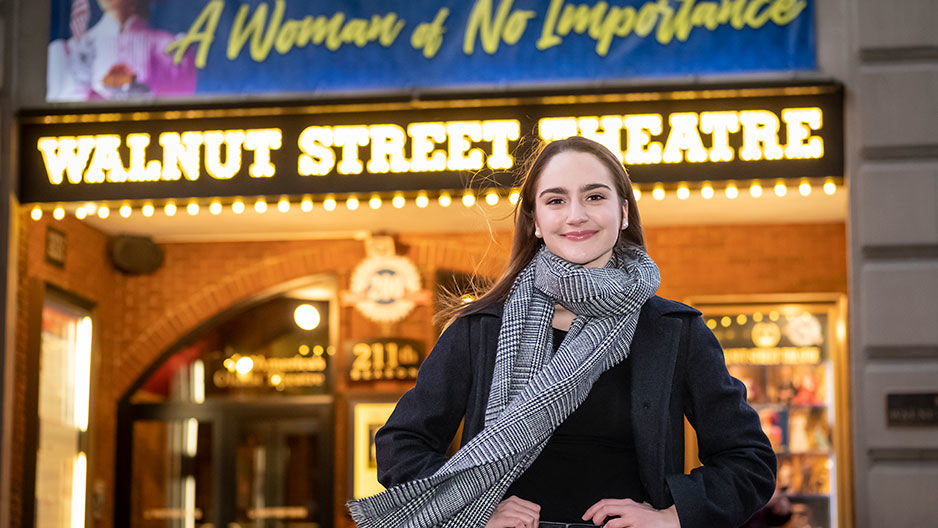 Audrey Ward standing in front of the Walnut Street Theatre in Philadelphia