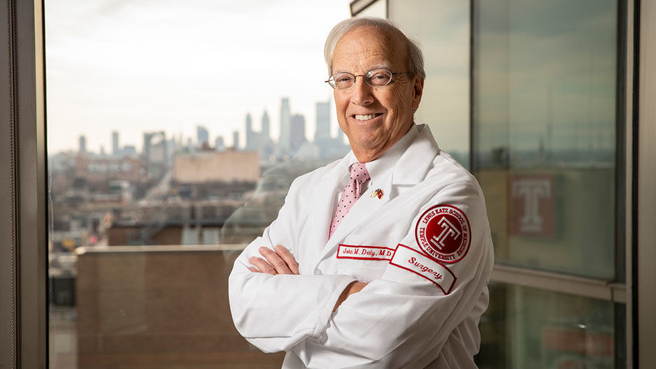 Dean Daly smiling in his white coat