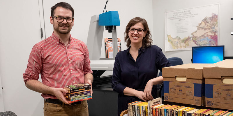 Librarians Michael Carroll and Stefanie Ramsay are part of a team at Temple Libraries digitizing science fiction books.