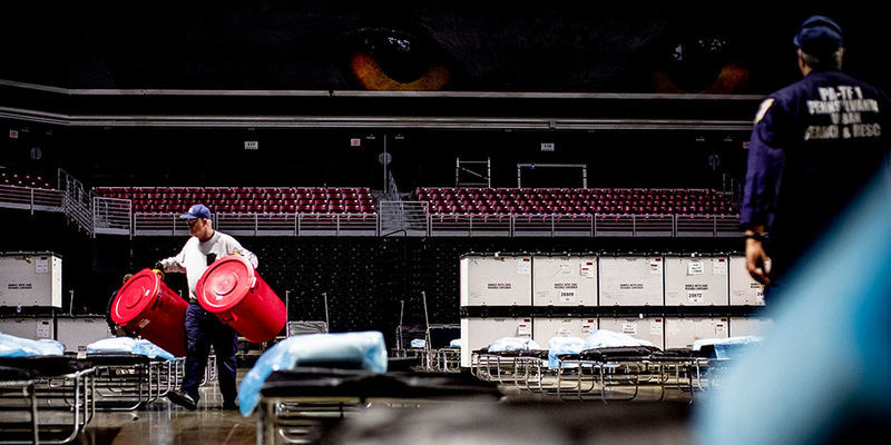 Emergency responders set up a field hospital in the Liacouras Center in March.
