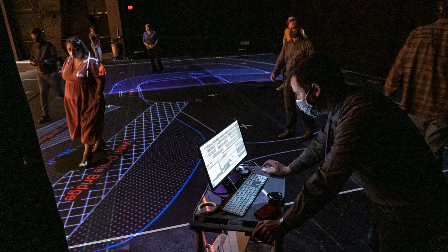 Temple University faculty try out a new projection mapping system.