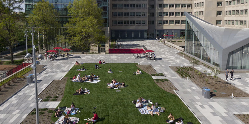 students lounging on Anderson Hall's new green space
