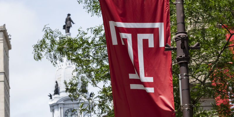 Temple flag flying in Center City.