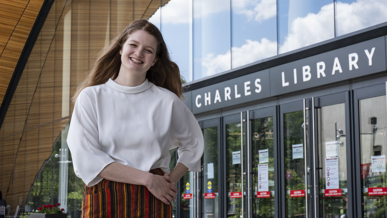 Kirtney Metz standing in front of Charles Library