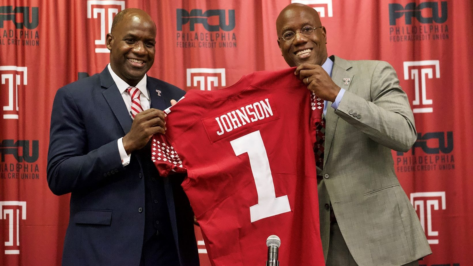 Arthur Johnson pictured with President Wingard, holding Johnson's replica Temple jersey.