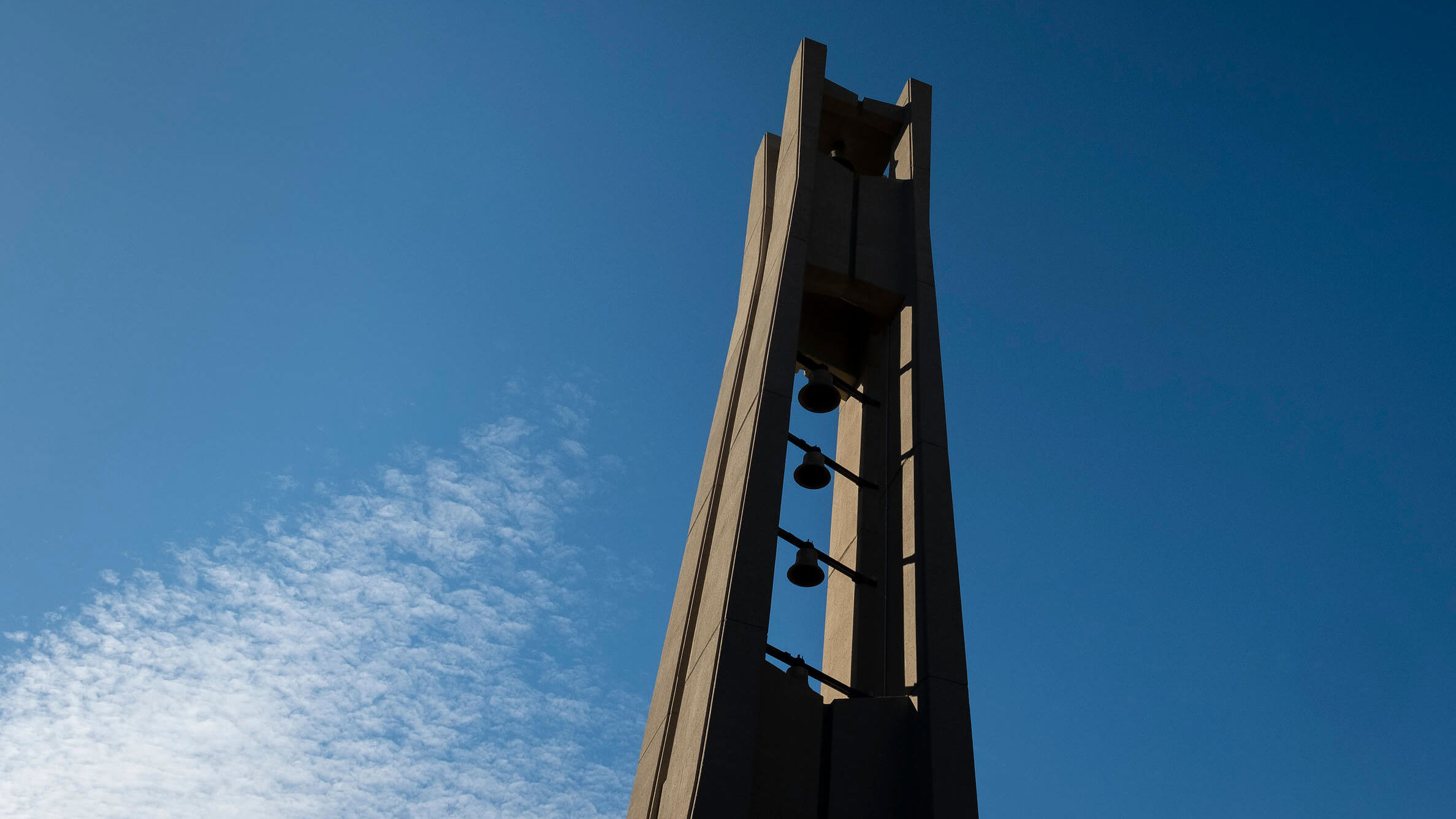 the Bell Tower rising toward a blue sky