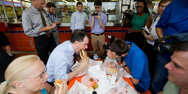A political candidate eating a cheesesteak in Philadelphia.