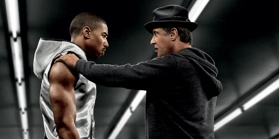 A poster promoting the film Creed with stars posing in a boxing ring.