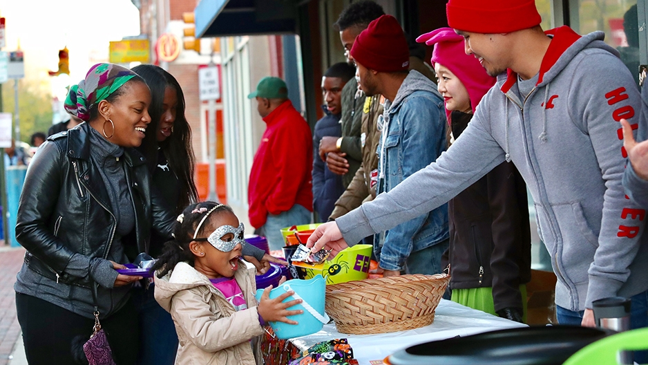 A girl accepting candy.
