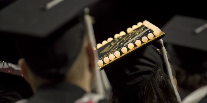 a view of graduates with caps decorated