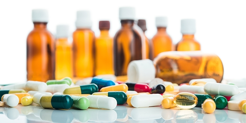 Bottles and pills on display.