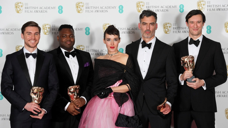 four men and a woman holding British Academy of Film and Television Arts awards.