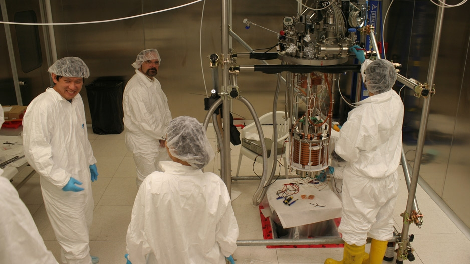 Physicist Jeff Martoff and fellow researchers in a lab