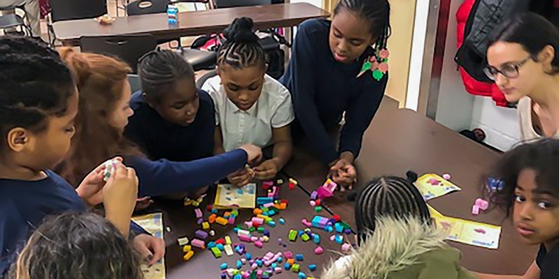 Children work together during the Norris Homes program