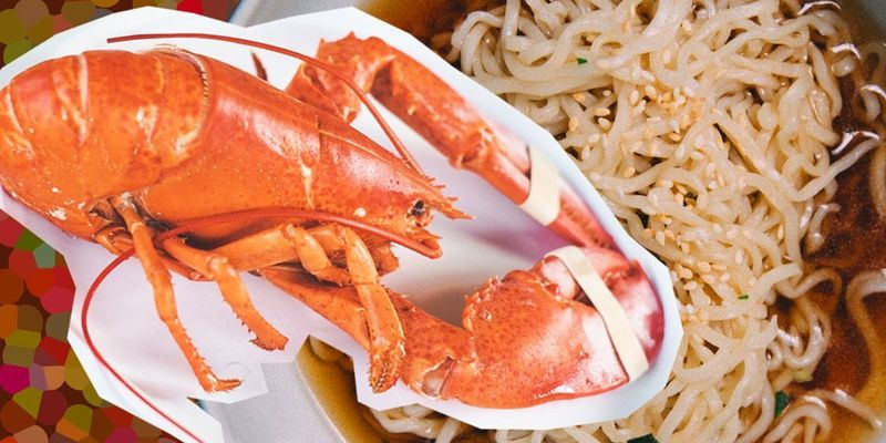 a graphic of a lobster with ramen noodles.
