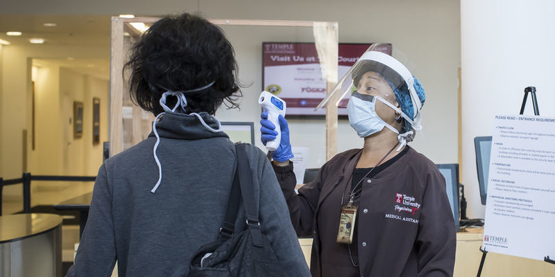 a medical assistant screening a patient