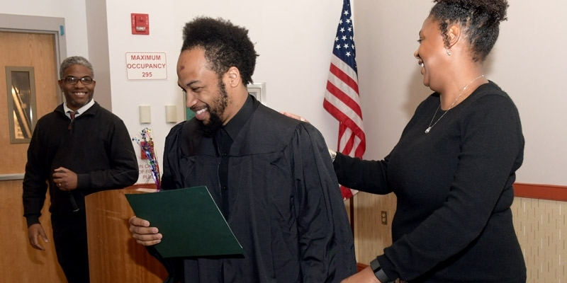 a graduate accepting his diploma