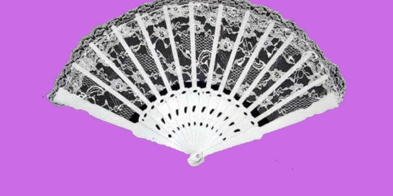 """A black and white image of a fan, part of the poster for """"The Country Wife."""""""