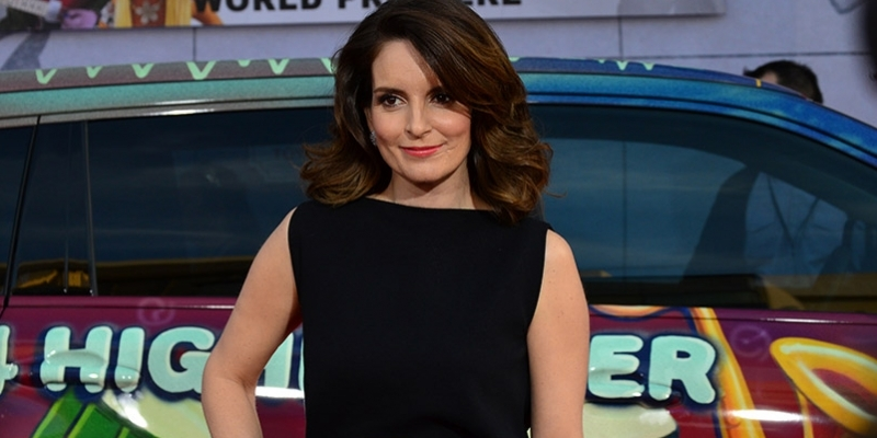 Actress Tina Fey posing at a film premiere.