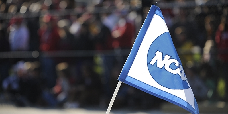 A white and blue flag with the NCAA logo.