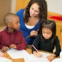 Teacher helping students in classroom