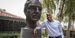 President Jason Wingard stands beside a bust of Temple University founder Russel Conwell.