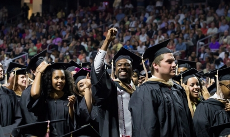 Graduates celebrating at Temple's Commencement ceremony.