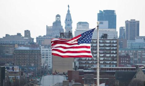 American flag with Philadelphia skyline